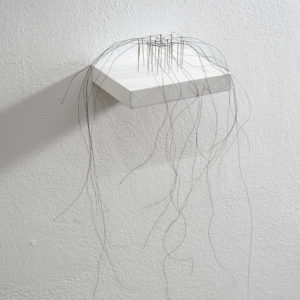 Kleines Haarnetz konkav (Little hair net concave), 2012, Horse hair, needles ca. 34 x 21 x 16 cm On pedestal: 1,8 x 12 x 10 cm