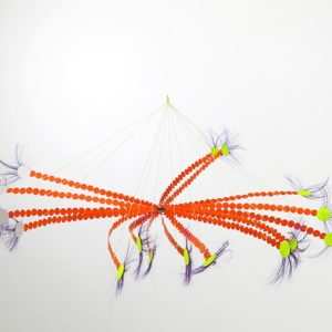 Colour Brolleke (orange), 2005, Iron, string, paper-stickers, glass pearls, synthetic hair diam 50 H 20 cm