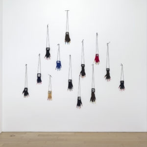 """Gants Grimaces"", 1990, 13 gloves, wool, colour- pencils, 13 b&w photographs Variable dimensions"