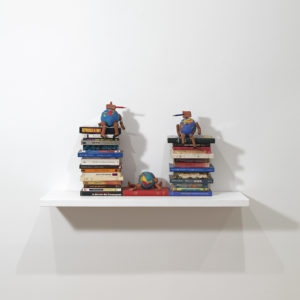 """Trois Mondes"", 2006, Books, 3 colour pencils and 3 terracota sculptures  24 x 32 x 38 cm"