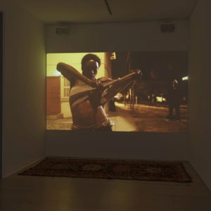 Installation view of: Until the Quiet Comes, 2012, Single channel colour HD projector (35 mm flim transferred to digital) Stereo sound Ed 1/3, 1AP Loop, running time: 3:41 (Music by Flying Lotus)