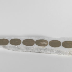 Untitled, 1992, Small piece of white Pendeli marble with mud drawing 24 x 5 cm (2 cm thick)