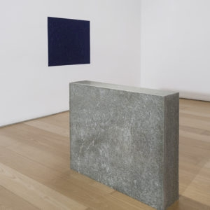 """""""Oltremare Verso Sud"""", 1967-2018, Yellow Lucerne granite, magnetic needle, glass, acrylic paint on wall Variable dimensions (Stone 70 x 80 x 16 cm, Oltremare 70 x 80 cm)"""
