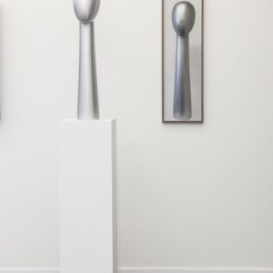 Mork, 2018, Plaster lacquered silver, framed ink jet print Sculpture: 80 x 20 x 20 cm Picture: 88,5 x 27 cm (framed)