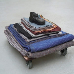 Mes Transports, 2012-13, Various objects, wood, metal, wheels, blankets, black wrap, 39 x 67 x 54 cm