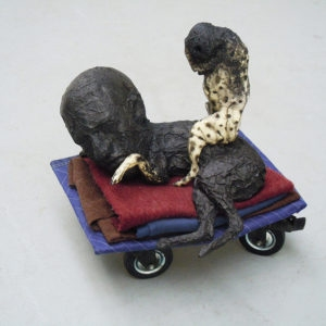 Mes Transports, 2012-13, Various objects, wood, metal, wheels, blankets, black wrap, 54 x 48 x 48 cm