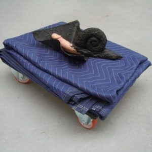 Mes Transports, 2012-13, Various objects, wood, metal, wheels, blankets, black wrap, 32 x 57 x 54 cm