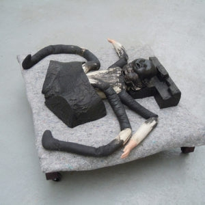 Mes Transports, 2012-13, Various objects, wood, metal, wheels, blankets, black wrap, 37 x 90 x 74 cm