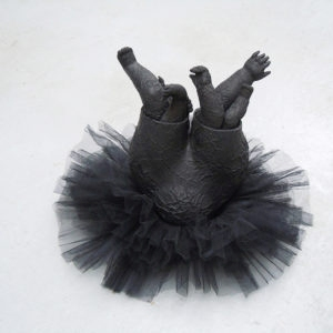 Mes Transports, 2012-13, Tutu, various objects, wood, metal, wheels, black wrap, 47 x 70 x 60 cm