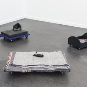 Mes Transports, 2012-13, 3 parts: Various objects, wood, metal, wheels, blankets, black wrap, 28 x 51 x 38 cm, 26 x 88 x 57 cm, 23 x 32 x 44 cm